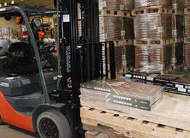 inside a warehouse with pallets and forklift